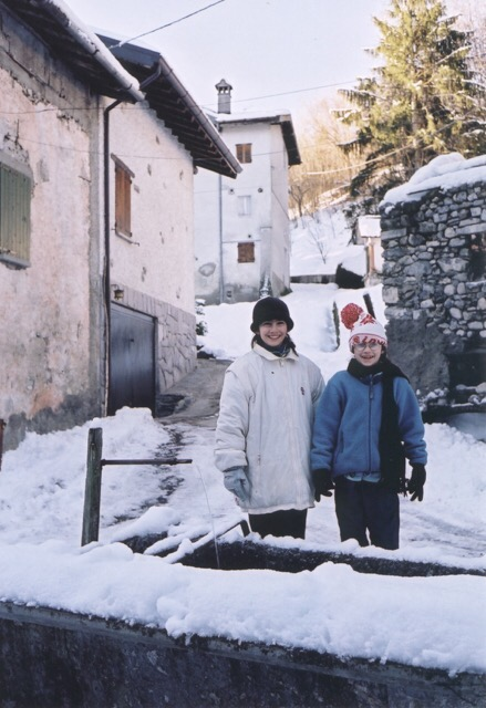 Cristina (right) and her sister Gabriella at the fountain in Scaria, circa 2001